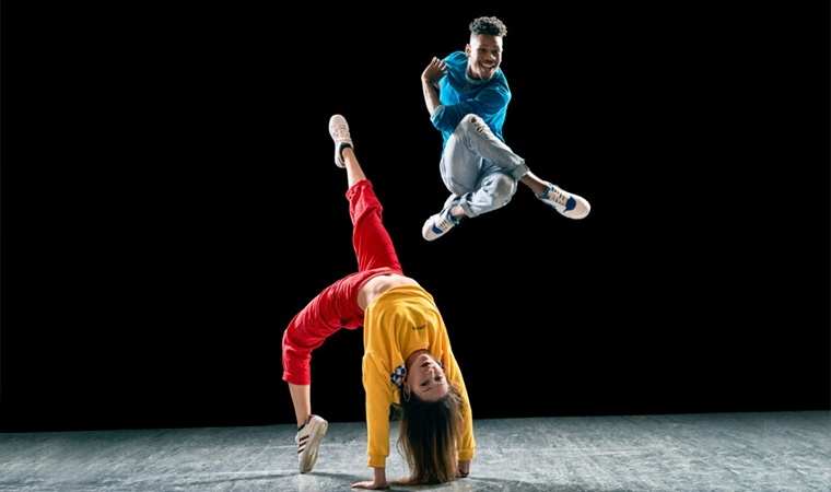 A stage with two members of Versa-Style Dance company dancing on it.