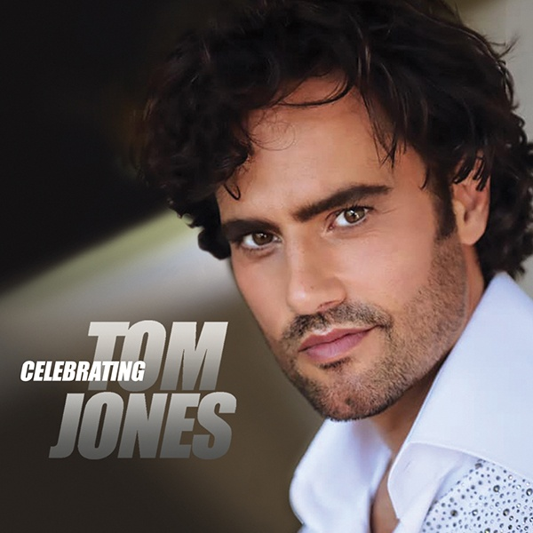 """David Burnham staring smolderingly into the camera with the words """"Celebrating Tom Jones"""" overlaid to one side."""