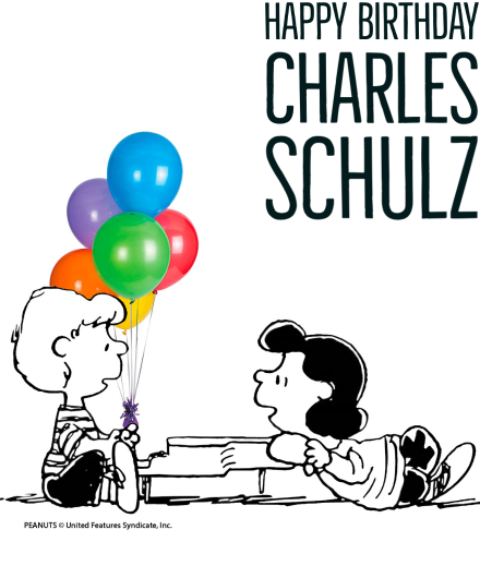 Happy Birthday Charles Schulz. Schroeder sits at the piano with Lucy nearby, balloons behind them.