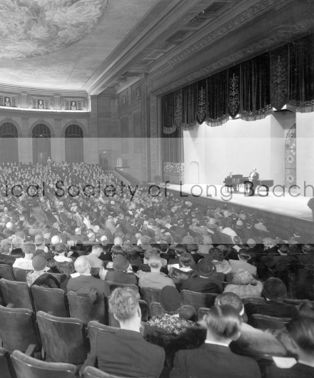 Interior of the Municipal Auditorium in Long Beach from 1932. A grand piano is seen on stage for a formal concert.