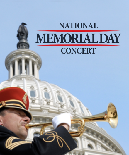 Image of a man in uniform playing the bugle with the Capitol dome behind him.
