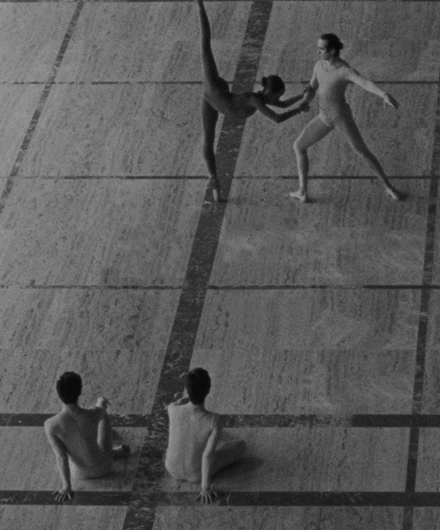 Black and white image of four dancers on the David H. Koch stage in NYC.