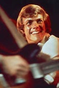 Richard Carpenter on stage, smiling