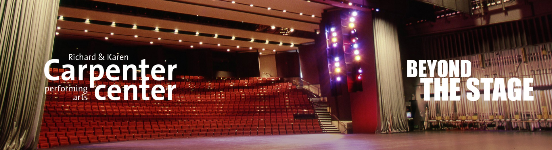 """A view of the Carpenter Center stage with the seating area illuminated. The Carpenter Center logo and the words """"Beyond the Stage"""" are superimposed on the image."""